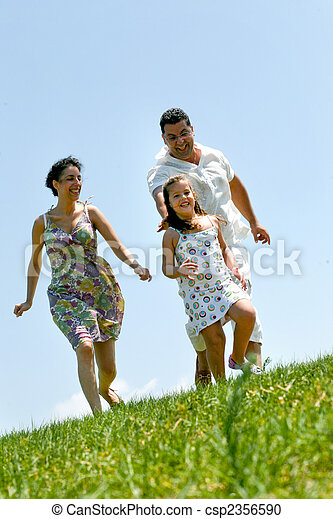 Family on herb under blue sky  - csp2356590