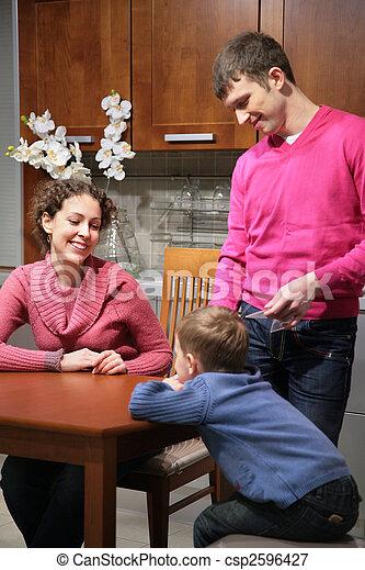 family on kitchen - csp2596427
