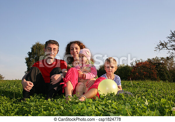 family on meadow - csp1824778