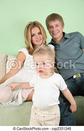 family on sofa - csp2331248