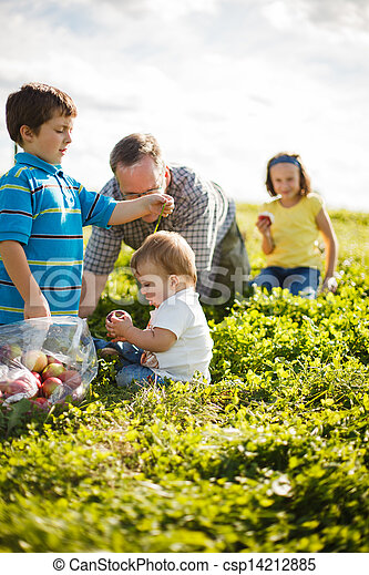 family on the grass - csp14212885