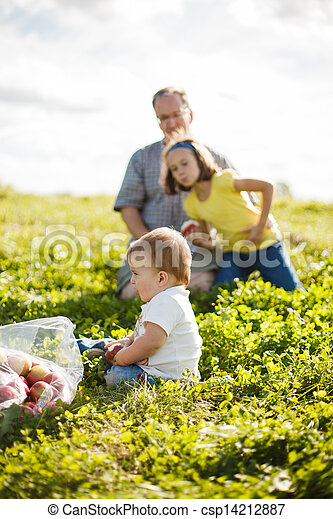 family on the grass - csp14212887