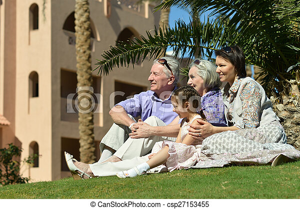 family on tropical resort - csp27153455