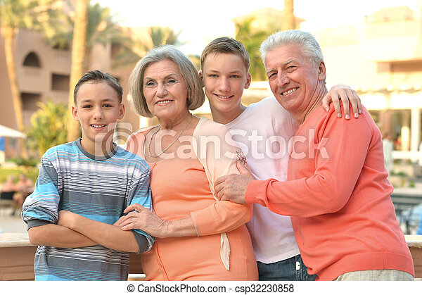 family on tropical resort - csp32230858