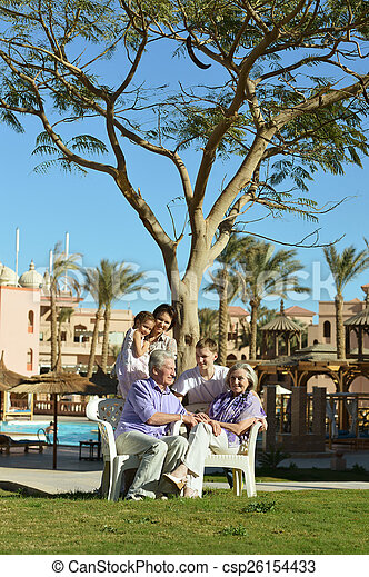 family on tropical resort - csp26154433