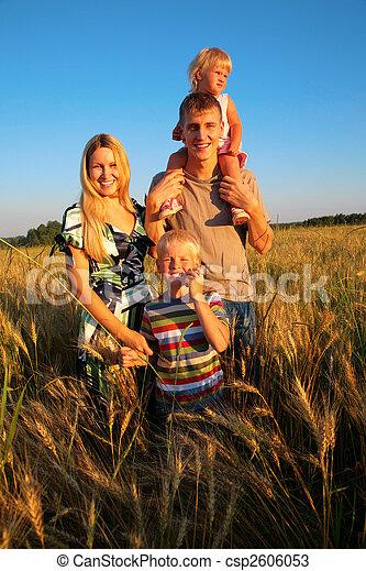 Family on wheat field - csp2606053
