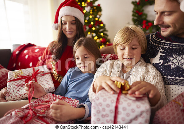 family opening christmas presents at home csp42143441