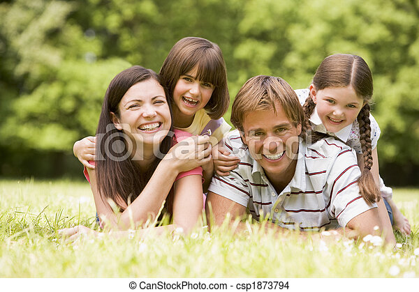 Family outdoors smiling - csp1873794