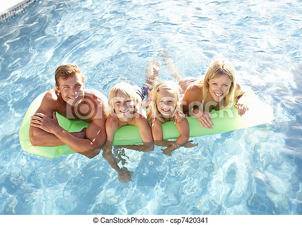 Family Outside Relaxing In Swimming Pool - csp7420341