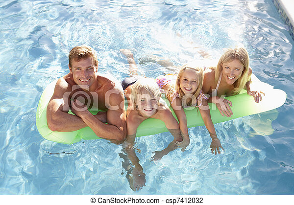 Family Outside Relaxing In Swimming Pool - csp7412032