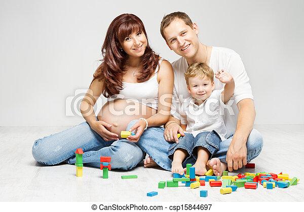 family, parents kid playing blocks - csp15844697