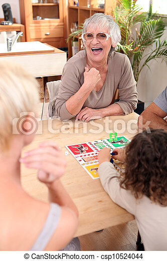 Family playing a board game - csp10524044