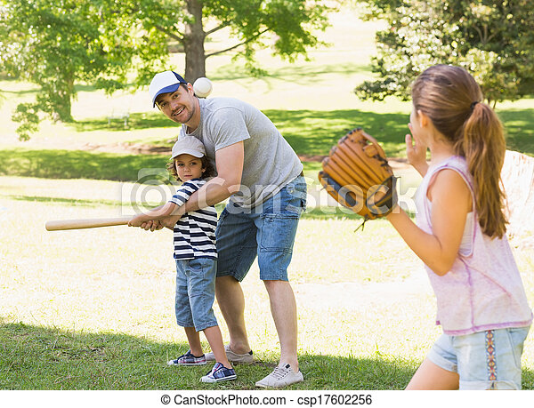 Family playing baseball in the park - csp17602256