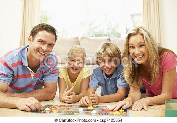 Family Playing Board Game At Home - csp7425654