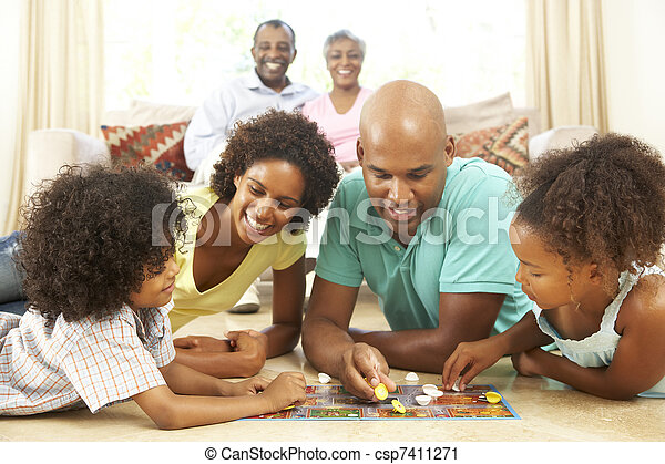 Family Playing Board Game At Home With Grandparents Watching - csp7411271