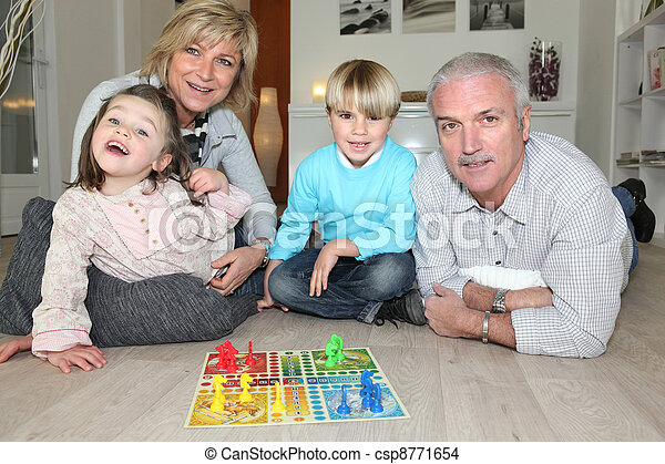 Family playing board game - csp8771654