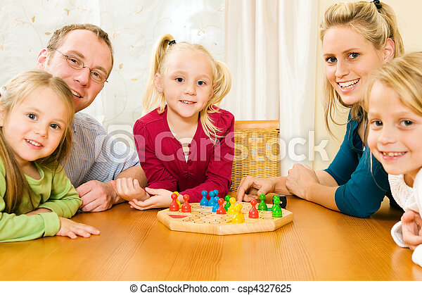 Family playing boardgame - csp4327625