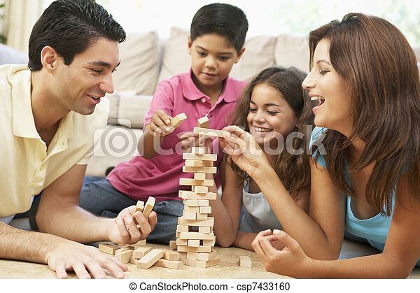 Family Playing Game Together At Home - csp7433160