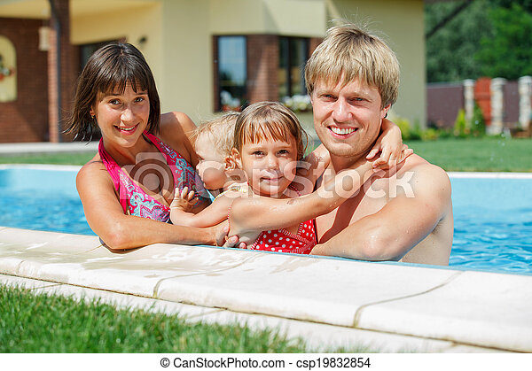 Family playing in swimming pool. - csp19832854