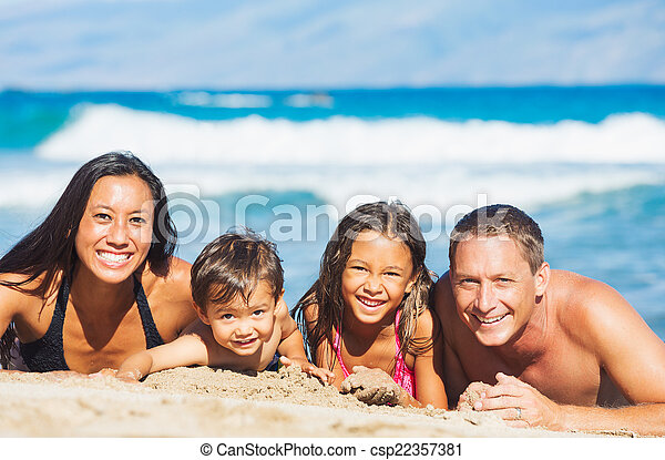 Family Playing on the Beach - csp22357381