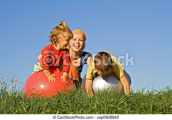 Family playing outdoors - csp0928643
