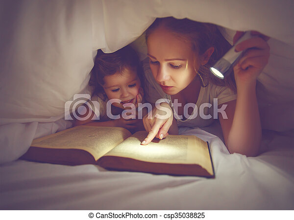 Family reading bedtime mom and child reading book with a stock family reading bedtime mom and child reading book with a flashlight under blanket csp35038825 sciox Gallery