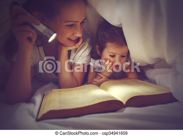 Family reading bedtime mom and child reading book with a stock family reading bedtime mom and child reading book with a flashlight under blanket csp34941609 sciox Gallery