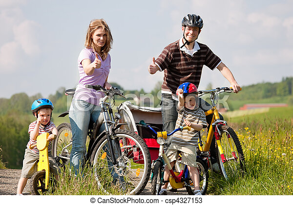 Family riding bicycles in summer - csp4327153
