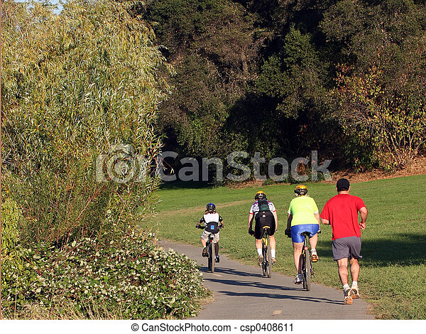 Family riding bikes  - csp0408611