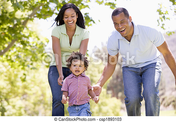 Family running outdoors smiling - csp1893103