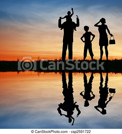 family silhouette on sunset sky. water - csp2591722