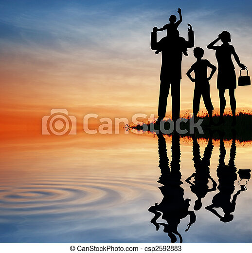 family silhouette on sunset sky. water - csp2592883