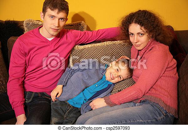 family sit on sofa - csp2597093