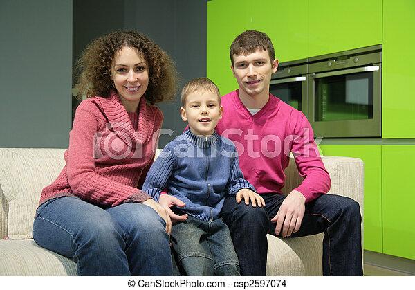 Family sits on sofa - csp2597074