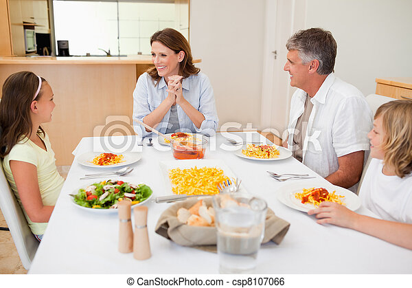 Family sitting at the dinner table - csp8107066