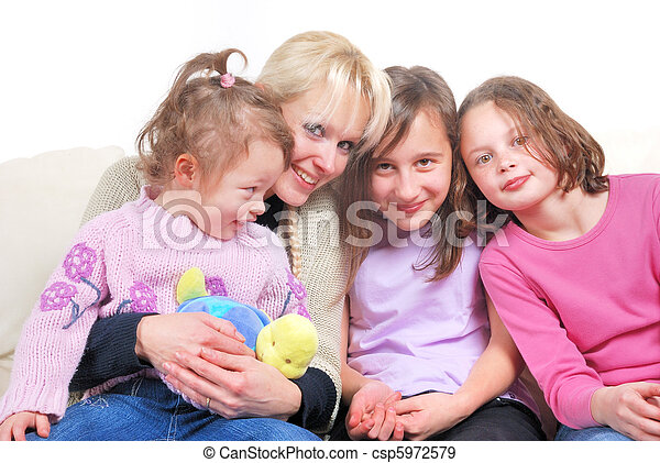 family sitting in living room on sofa stock photographs - Search ...
