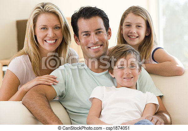 Family sitting in living room smiling - csp1874051