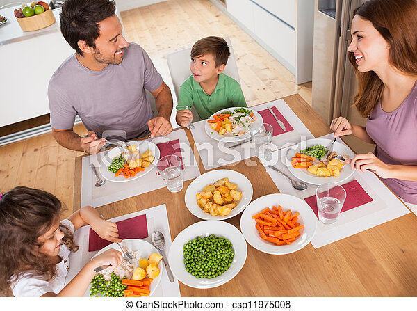 Family smiling around a healthy meal - csp11975008