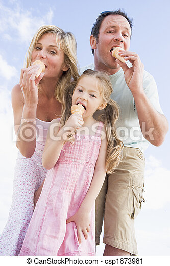 Family standing outdoors with ice cream - csp1873981