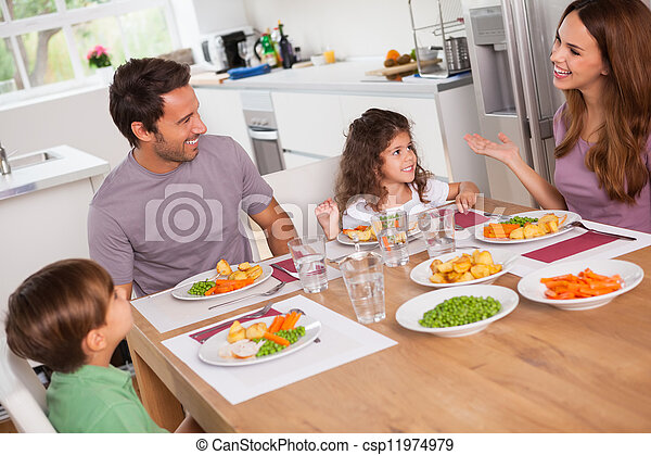 Family talking around the dinner table - csp11974979