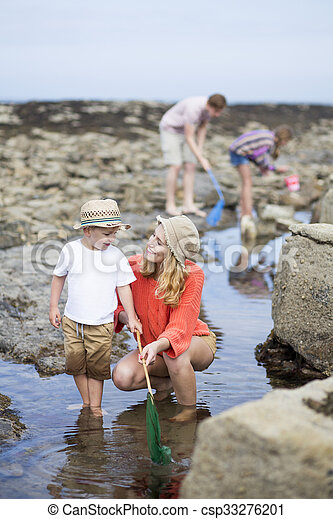 Family time at the beach - csp33276201