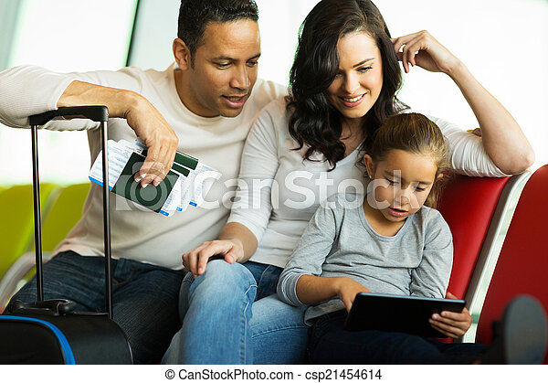 family using tablet computer at airport - csp21454614