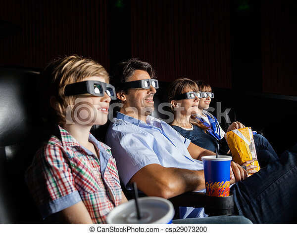Family Watching 3D Movie In Theater - csp29073200