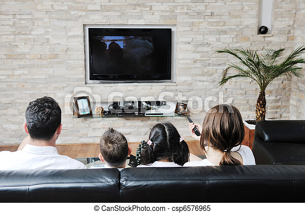family watching flat tv at modern home indoor - csp6576965