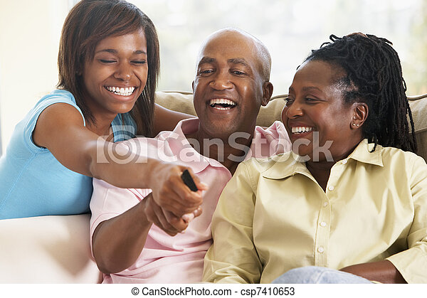 Family Watching Television Together - csp7410653