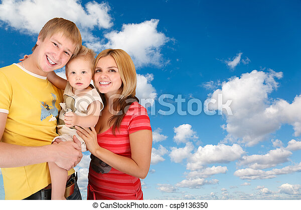 family with boy on White, fluffy clouds in blue sky collage - csp9136350