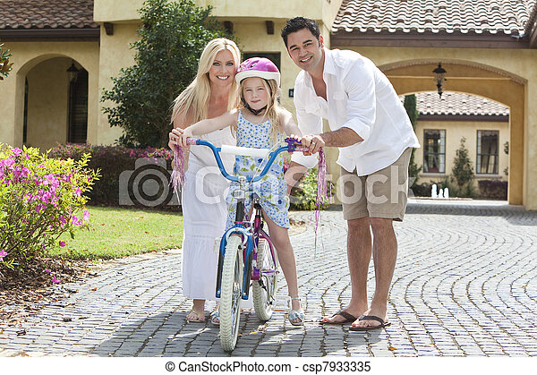 Family WIth Girl Riding Bike & Happy Parents  - csp7933335