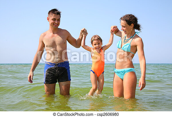 Family with little girl in sea - csp2606980