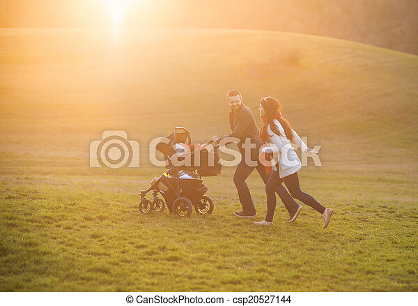 Family with pram in nature - csp20527144