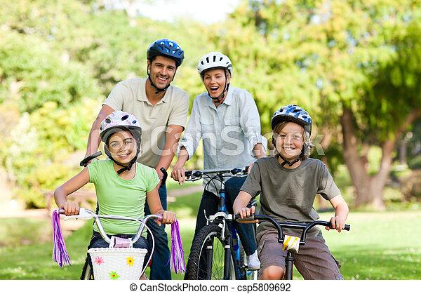 Family with their bikes - csp5809692